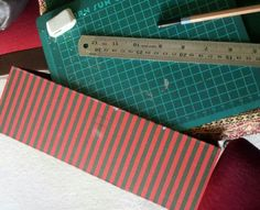 STEP 3: Place your cutting mat on a corner of your table and then hang the box over the corner so your marked rectangle is over the mat.