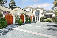 I love the tiled roof and wood garage doors.