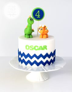 Boy's dinosaur birthday cake fondant dinosaur cake toppers and fondant chevron detail