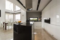 Big modern kitchen connected with spacious dining room