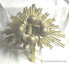 Remate capilla Sol tallado en madera, S. XIX. Dorado en pan de oro, muy buen estado 150 €