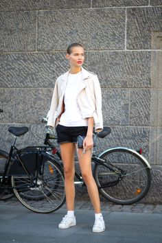 15 chic sneaker outfit ideas that fashion insiders swear by: a leather jacket, white t-shirt, shorts and sneakers