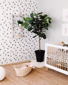 Neutral Boho Nursery with Black and White Triangle Accent Wall