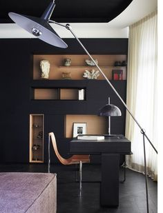 """Bismut & Bismut - Paris, paired a 1952 leather sling """"T"""" chair made by Katavolos, Littel and Kelly and a vintage Gino Sarfatti lamp - A contemporary office space in a Parisian apartment."""