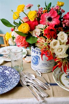 Colorful tabletop.  Love those blue floral plates!