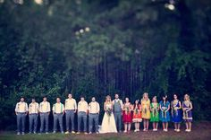 A slight variation on my idea for wedding party colors...except I would have both men and women wearing black and white with the rainbow colors as accents (on sashes, ties, etc.). Love the rainbow shoes on the guys!