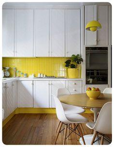 Yellow subway tiles as splashback in white kitchen