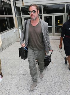 """""""World War Z"""" actor Brad Pitt arriving on a flight at LAX airport in Los Angeles, Calif., on July 21."""