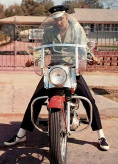 Elvis on his 1956 Harley-Davidson KH