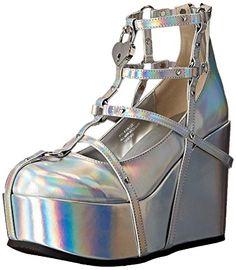 Demonia Women's Poi25-2/Shgvl Ankle Bootie, Slv Hologram ... https://www.amazon.com/dp/B01MU09FYL/ref=cm_sw_r_pi_dp_x_9m4wzb6J244WS