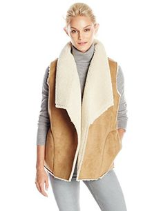 This faux sherpa vest by VELVET BY GRAHAM & SPENCER is the perfect fall layering piece.