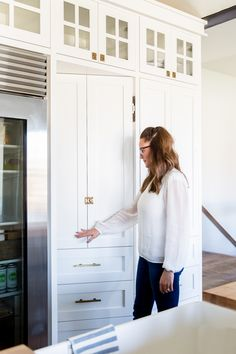 pantry is hidden with a faux cabinet front door.