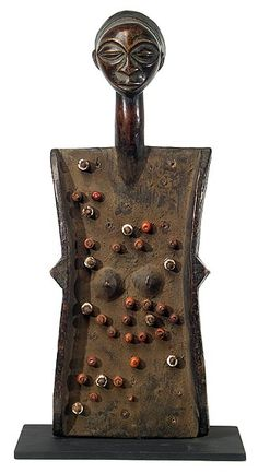 """LUBA Lukasa memory boards help to maintain and transmit historical knowledge. The """"reading"""" of them is a performance.  They take the form of a woman/tortoise body with a beautifully carved head."""