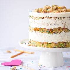 The Ultimate Birthday Cake. A sweet funfetti cake, topped with a cream cheese buttercream, and delicious cookie crumble.