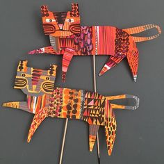 I made these two by covering bits of card with scraps of paper painted with gouache. The legs are held with rolled pegs of paper, so they can move. They started off as tigers but I don't think they are fierce enough. #collageart #papercraft #papertoy #artoftheday #arteveryday