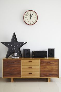 Michelle's retro style Boundary Sideboard in Walnut topped with the Broadway Star Floor Lamp in Black.   made.com/unboxed