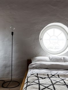 The wooden window in the form of a porthole with an electric shutter in the same form, able to transform the window into a single piece of furniture in its kind.