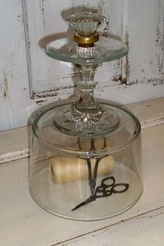 Glass dome display cloche. this is just clever. love the glass doorknob on top.