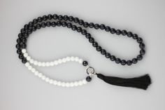 The Empress Tassel Necklace - Semi precious faceted Charcoal and White Jade beads