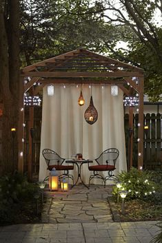 What a difference a little lighting can make! This gazebo glows with illumination from several sources: strings of bulbs, candle chandeliers, solar-powered landscape lights, battery-operated lanterns and overhead fixtures. Not only do these lights guide your footsteps through the yard as the sun is setting, they also conjure cozy ambience at twilight and beyond.