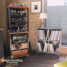 Those fortunate enough to have a vinyl collection, now is the perfect time to sit back and enjoy them.🎵 We built this little cabinet on the right specifically for storing vinyl. We can build it with or without casters, bigger, taller; you let me know. Actually we can customize any of our pieces to accommodate a vinyl collection. We are still taking orders, do not hesitate to ask for quote. We will get through this and be 🙏 safe everyone. #recordcollection #vinylcollector #industrialfurniture Modern Industrial Furniture, Vinyl Collectors, Vinyl Storage, Small Cabinet, Record Collection, Sit Back, Bookcase, Quote, Shelves