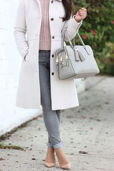 Grey skinny jeans, blush cable knit sweater, wool coat, grey tassel purse and pumps