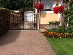 Entrance gates finished in black with gold painted fleur de lys features. Small entrance gate in width and in height. Small Entrance, Entrance Gates, Driveway Gate, Fence, Wrought Iron Gates, Gate Design, Garden Gates, Gold Paint, Sidewalk