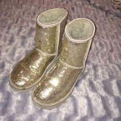 Ugg gold sparkly boots UGG Australia gold boots! I have worn them 2 times they are in AMAZING shape. Size 5!! UGG Shoes