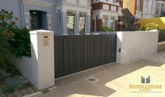 Automated sliding aluminium driveway gate installed in Chiswick. Powder Coated Black Grey RAL 7021 and automated by BFT ARES Ultra.