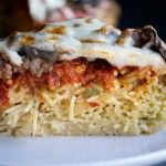 An easy Spaghetti Pizza Pie recipe with pasta for the crust with pizza toppings like sausage, peppers and mushrooms piled high in a pie plate. Meat Recipes, Pasta Recipes, Spaghetti Pizza, Interesting Recipes, Italian Cooking, Pie Plate, Deep Dish, Pot Pie