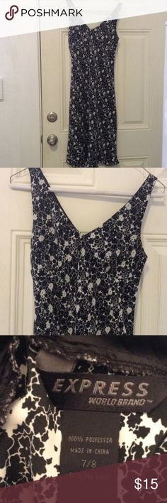 Express world brand V-neck dress Beautiful black and white floral V-neck dress, Express Worldwide, knee length, lightly used, great condition. Perfect for a first date, you can even wear it to a wedding. Can be paired with some strapped black heels, teardrop earrings, and a dainty necklace Express Dresses