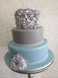 Blue and grey ruffle cake with crystal banding
