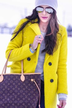 yellow coat + aviators.