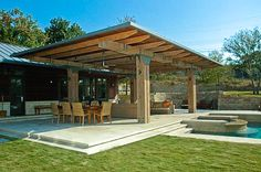 Chunky and industrial pergola by Larry Anderson Construction.