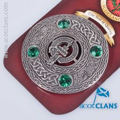 Pewter plaid brooch with Morrison clan crest and emerald coloured stones
