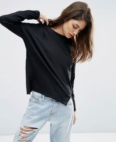 http://www.quickapparels.com/women-long-sleeve-top-with-side-splits-t-shirt.html
