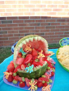 Watermelon shark complete with Sweedish Fish and Sour Octopi. (The carving was done by a friend, I did the filling, eyes, fin)