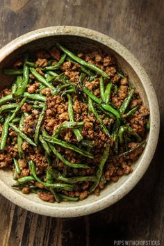 Simple dry-fried long beans & minced pork dish seasoned with umami packed Chinese olive vegetables. Delicious mixed with rice for a quick & flavourful meal