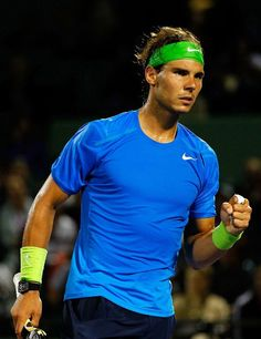Rafael Nadal of Spain color blocks on the court in Nike blue & green.  March 2012.  #tennis