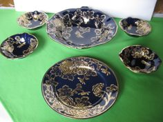 For your purchase is a Nippon China Cobalt Blue Raised Gold Flowers Berry Bowl and Five 5 Berry Bowls and Plate. The flowers and leaves on