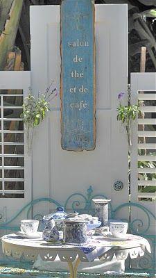 Lovely garden spot....great idea, a wall of shutters