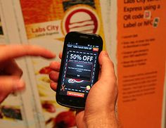 NFC Coupons - Tap coupon with your NFC enabled phone to save coupon on your phone to be used at a retail outlet.