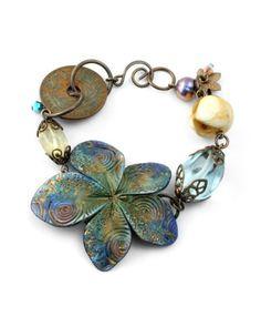 Aqua Blossom bracelet by Megan Sharkey.  Barb Fajardo Flora bead.