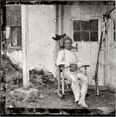 1863 photo of John L. Burns, War of 1812 veteran and sharpshooter in the Battle of Gettysburg.     Burns, born ca. 1793, was a 70-year-old veteran of the War of 1812 when he was wounded in the Battle of Gettysburg, having volunteered his services as a sharpshooter to the Federal Army. He died of pneumonia in 1872. Mr Burns' flintlock is at half-cock with the frizzen down, ready to ready to fire.