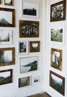 I like the mix of wood, white, and whitewashed frames. I also like the mix of black/white and muted color photos... Not on a white wall though!