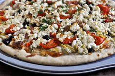 Greek pizza - feta, roasted bell peppers, garlic, mozzarella, artichoke hearts, kalamata olives, red onions, tomatoes...hmmm.