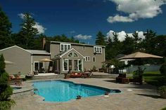 Fiberglass pool with pool deck and landscape
