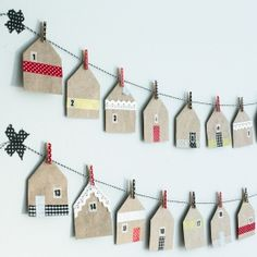 Fold gift bags in the shape of small houses and use as a Christmas calendar. Decorate with washi tape. Tutorial in English & Swedish.