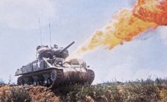 Sherman Tank equipped with flamethrower fitted to the bow machine gun ball-mount, circa 1944.