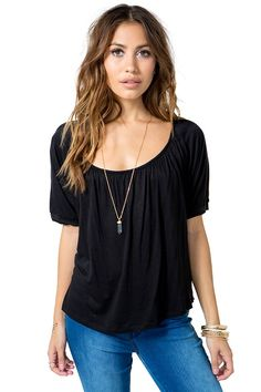 A romantic and feminine blouse, featuring a wide round neck, pleating, short Dolman sleeves and sheer lace back with a single button embellishment. Loose-fit silhouette. $16.50
